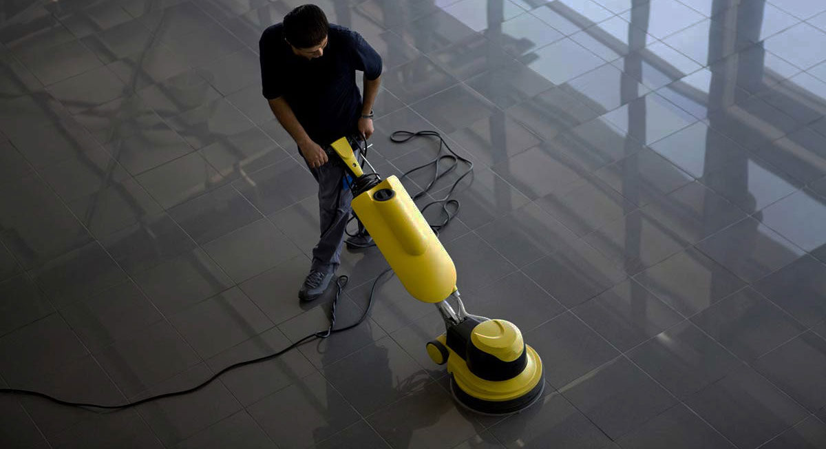 Commercial cleaning company polishing the floor