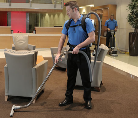 person cleaning in a business