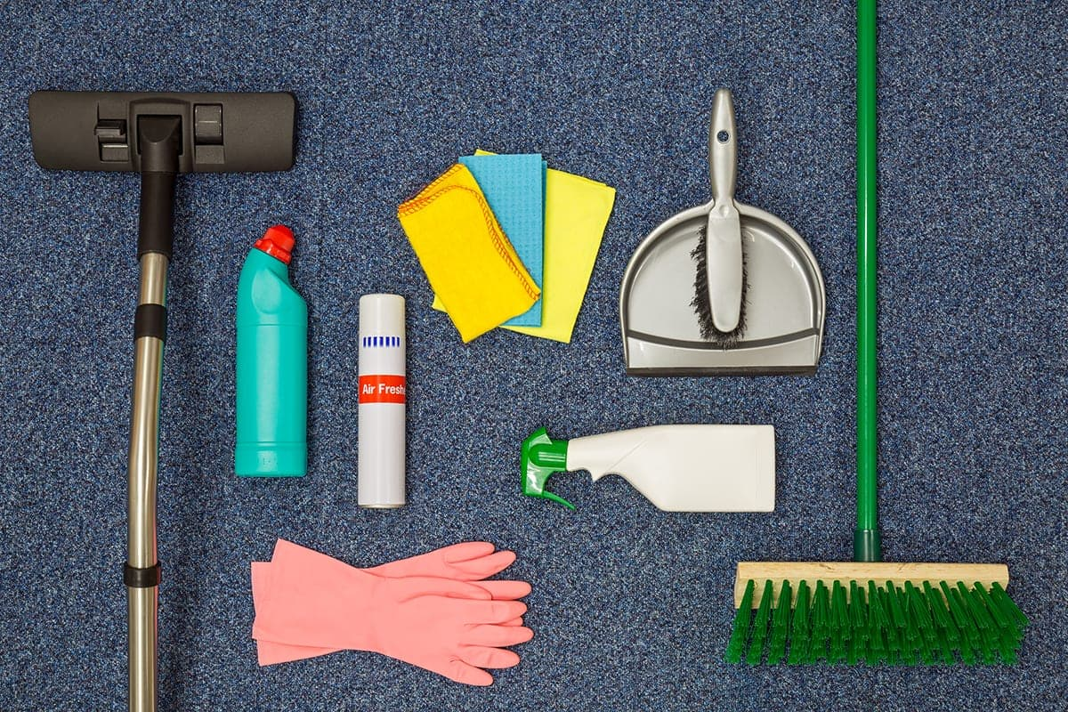 Range of commercial cleaning supplies spread across the floor