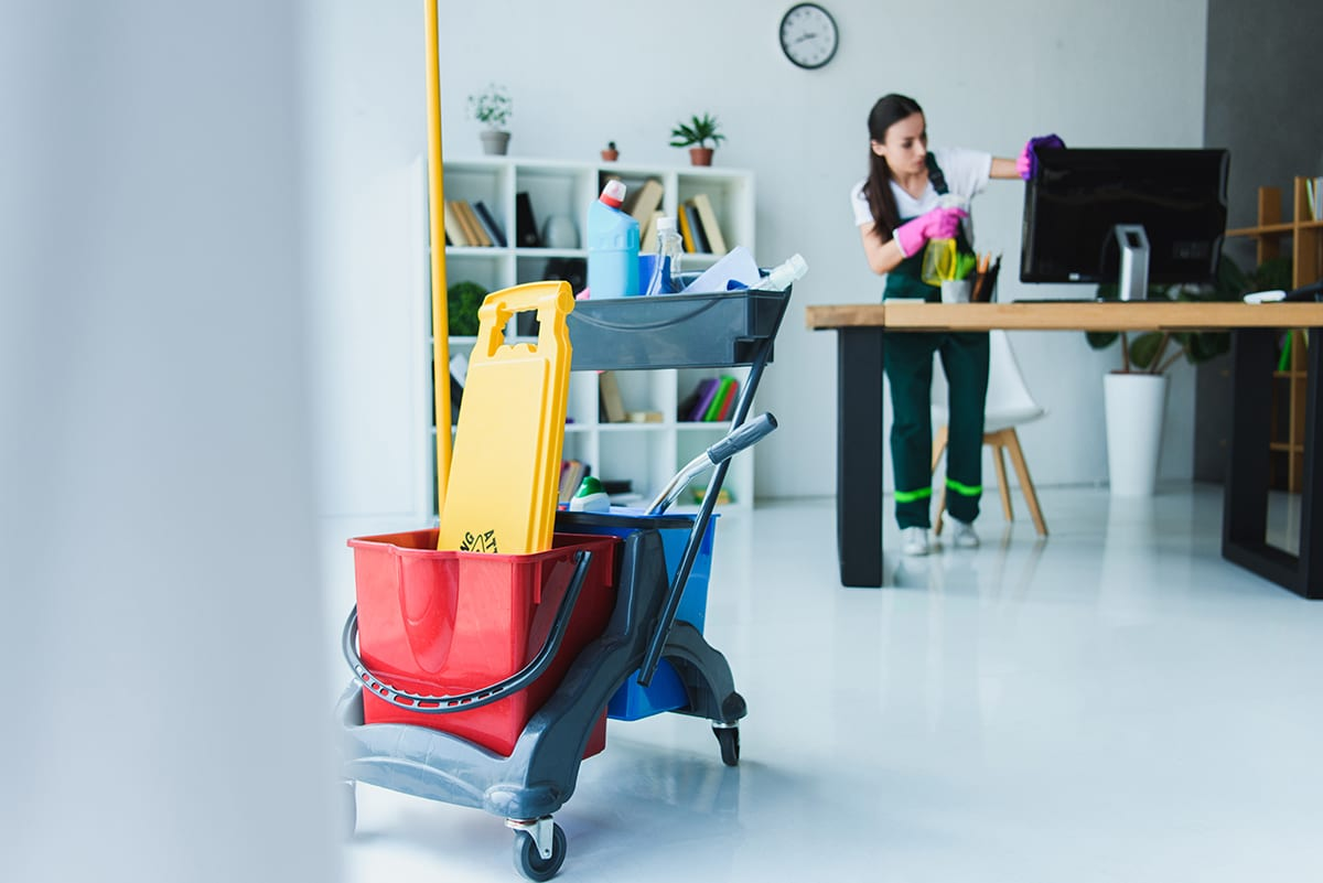 Jani-King commercial cleaner cleaning an office workplace